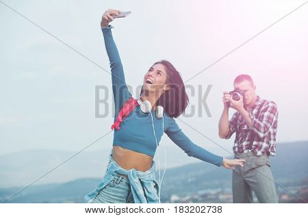 Handsome Man Photographing Happy Girl Smiling And Taking Selfie