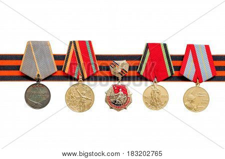 VELIKY NOVGOROD,RUSSIA-CIRCA APRIL,2017. 9 May background. 9 May holiday. St George's ribbon and medals of Great patriotic war isolated on white background. 9 May Victory day concept