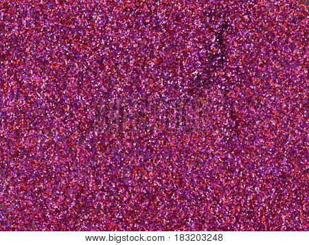 Abstract Christmas pink and purple glitter texture. Luxury magenta mixed color background with sparkling details. Cosmetics or holidays gift backdrop