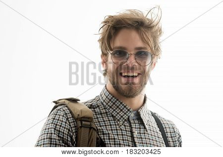 Happy handsome man or smart male student businessman smiling in nerd glasses and stylish blond hair haircut in checkered shirt with suspenders. Joy and happiness