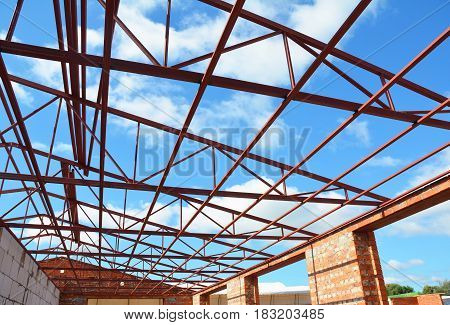 Metal Roof Frame House Construction. Metal roof-trusses. Roofing Construction.