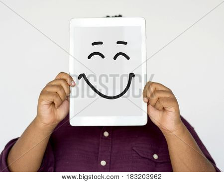 Woman Face Covered with Digital Tablet