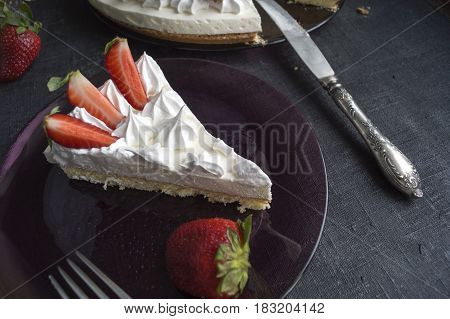 Shortcrust pie with soufflé and meringue. with strawberries and mint