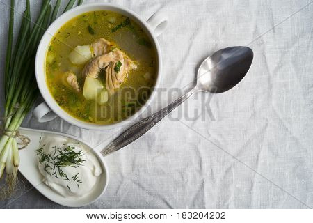 Fresh Fish Soup With Sour Cream And Onions, On A Linen Tablecloth.