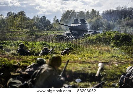 Rosowek Poland april 23 2017: German soldiers and russian tank. Historical reconstruction soldiers fighting during World War II