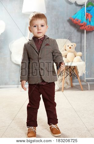 Cute little boy in dressing room