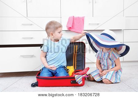 Cute small kids playing in wardrobe