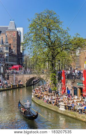 UTRECHT, NETHERLANDS - APRIL 09, 2017: Venetian gondola in the historic Oudegracht canal of Utrecht, Holland
