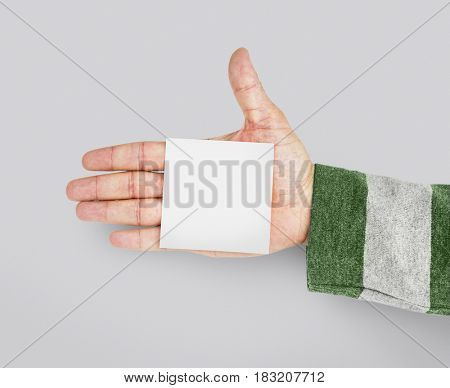 Hand holding network graphic overlay paper
