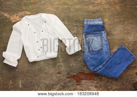 Children's clothing: shirt  and jeans. Top view.