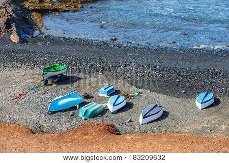Green Lagoon At El Golfo With Fishing Boats On The Beach, Lanzarote Island, Spain