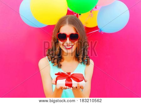 Portrait Happy Smiling Young Woman Holds In Hands A Gift Box Over An Air Colorful Balloons Pink Back
