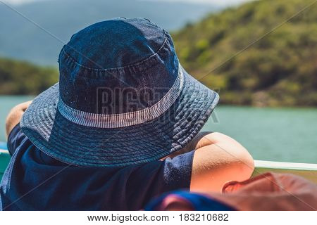 Adorable Boy Looking To The Blue Sea From Yacht Board In Sunny Day