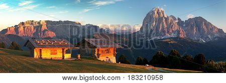 Evening panoramic view of two small cabin Sella Gruppe or Gruppo di Sella and Langkofel South Tirol Italian dolomites mountains Italy
