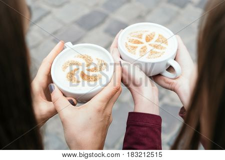 Cappuccino top view. Concept of drinking cappuccino in the circle of friends