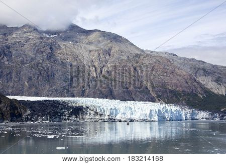 The view of a glacier with a mountain in Glacier Bay national park (Alaska).