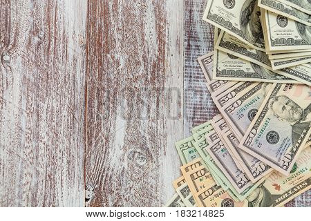 money isolated on a wooden background