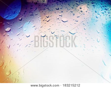 Positive abstract background with drops of water and bokeh. Close-up. The selected focus. Storm. A party. Dew. Drops of rain on glass rain drops on clear window Blue Abstract Water Drops Background. water drops on glass surface as background.
