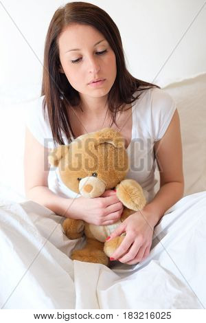 Sad Girl Getting Lonely And Hugging Soft Teddy Bear
