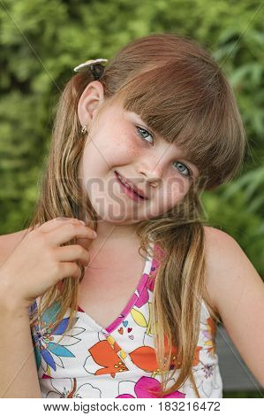 Portrait of young girl with pigtails in summer poster