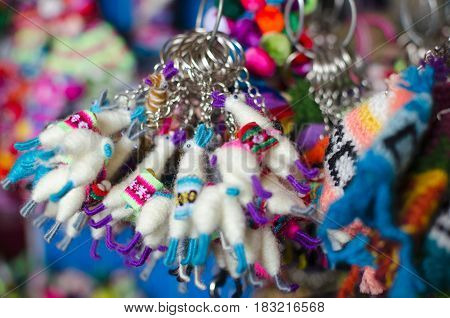 CUZCO PERU 08 FEBRUARY 2017: fluffy lama key pendants at the souvenir market
