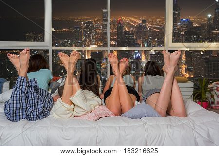 Focus on legs of attractive women. Young ladies watching at beautiful Chicago city. Pajama party