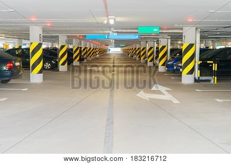 Underground car parking - rows of parked cars with perpective