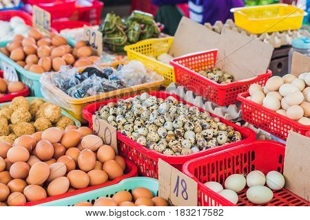 The Eggs - Chicken And Quail In The Wicker Basket On The Vietnamese Market. Asian Food Concept
