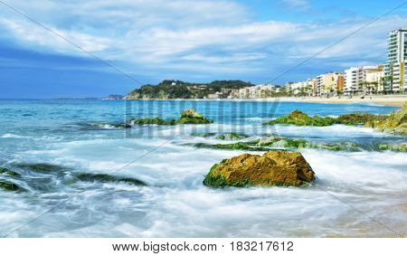 a view of the seafront of Lloret de Mar and the main beach of this popular tourist village in the Costa Brava, in Catalonia, Spain