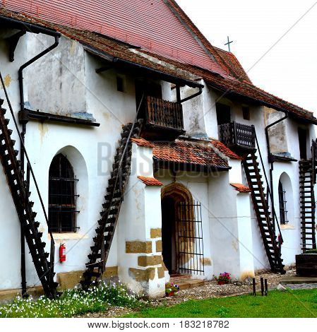 Courtyard of fortified medieval saxon church in the village Harman, Transylvania, Romania. Since its founding around the 13 century it was one of the most important villages in the Burzenland area, where there was a strong Transylvanian Saxon community