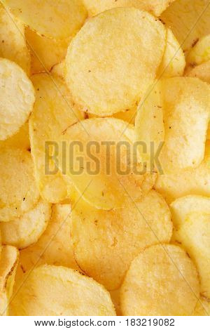 Crispy potato chips background. the top view