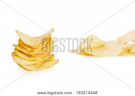 stack of crispy potato chips isolated on the white background  close-up