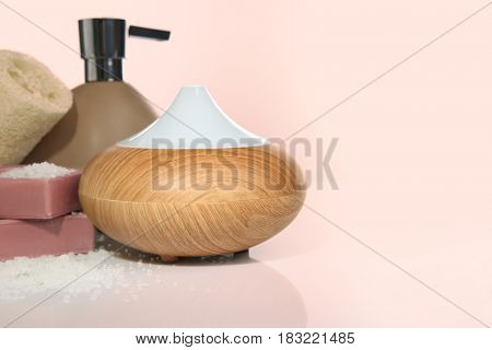 Oil diffuser on color background