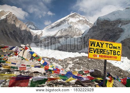 signpost way to mount everest b.c. Khumbu glacier and prayer flags Everest area Nepal