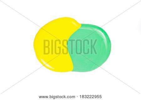 Blot of yellow and green nail polish isolated on the white background