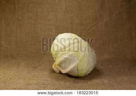Head of cabbage lies on the cloth. Tasty useful food