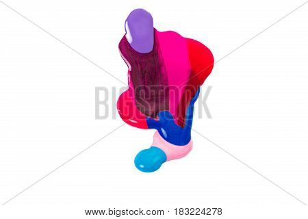 spilled colorful nail polish isolated on white background. blue and pink paint  stains.