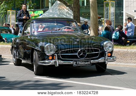 """BERLIN - MAY 28: The sports car Mercedes-Benz 190SL the exhibition """"125 car history - 125 years of history Kurfurstendamm"""" May 28 2011 in Berlin Germany"""
