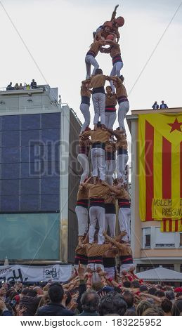 REUS SPAIN - APRIL 23 2017: Castells Performance in the Sant Jordi day a castell is a human tower built traditionally in festivals within Catalonia. This is also on the UNESCO Intangible Cultural Heritage of Humanity