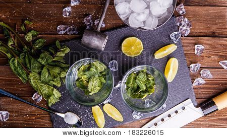 Components for fresh mojito cocktail on black stone board