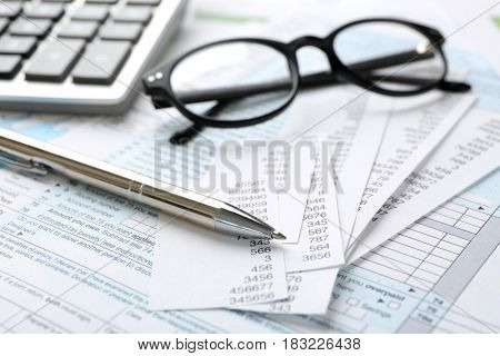 Pen with documents, closeup. Tax concept