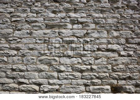 a white brick wall background with sandy cement and texture