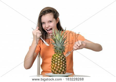 Expressive Teenage Girl Sticks A Knife And Fork Into A Pineapple.
