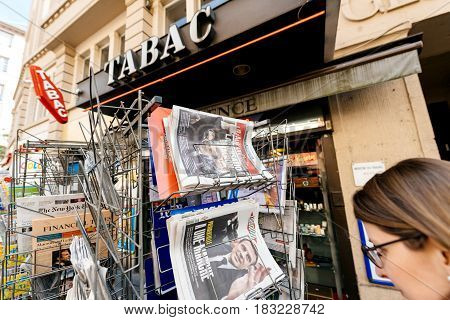PARIS FRANCE - APRIL 24: Woman buy looks at press kiosk at French newspaper Liberation Aujord'hui with pictures of French Presidential election candidates Emmanuel Macron Marine Le Pen a day after first round of French Presidential election on April 23 20