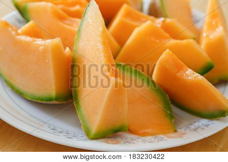Cantaloupe slices on a plate.