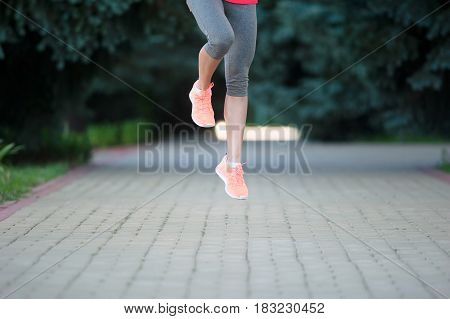 Runners sprinting outdoors. Sportive woman training in a urban area healthy lifestyle and sport concepts