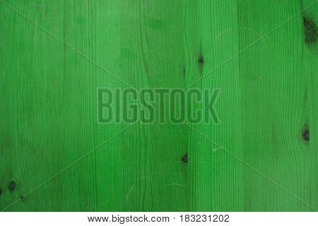 Green painted wood background. Green wood texture. Macro view of vintage painted wood.