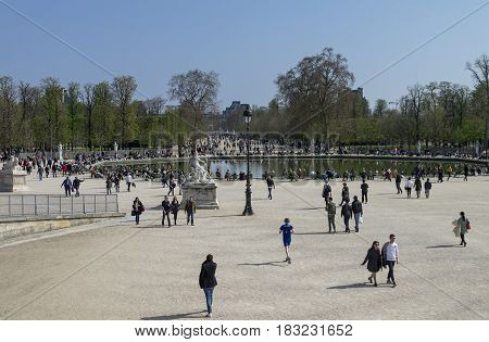 PARIS FRANCE - MARCH 26 2017: Tuileries garden at weekend. End of March sunny. Paris; France.