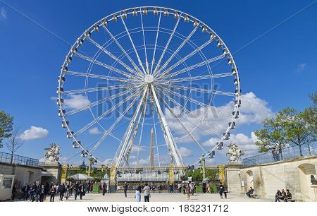 PARIS FRANCE - APRIL 2 2017: Ferris wheel at the Place de la Concorde in Paris. A sunny day in early April.