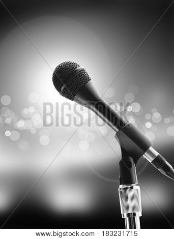 Beautiful microphone on the stage on the background of the audience